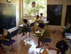 children writing exam