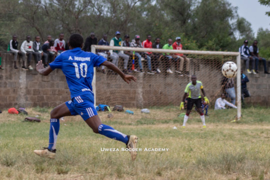Uweza Soccer Academy participating in a match