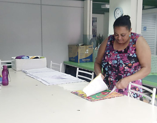 Atenizia selecting fabric in the ACER sewing room