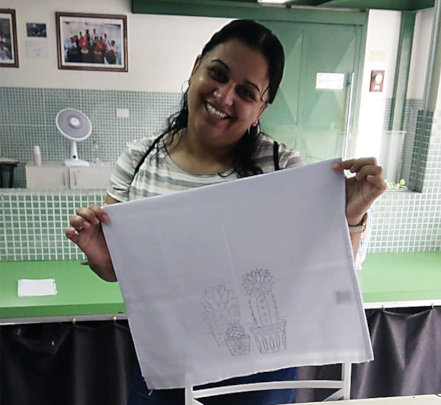 Viviane with a tea towel for embroidering