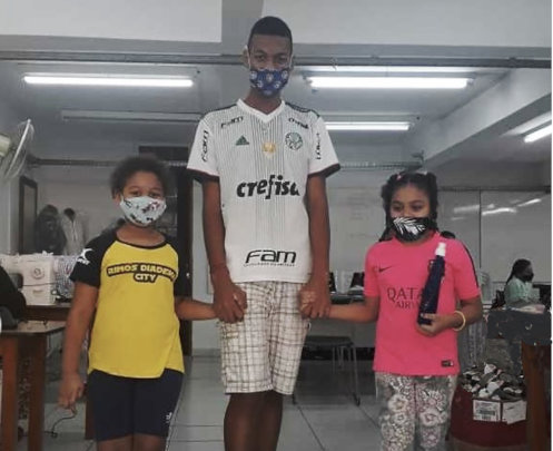 Sports teacher and pupils with ACER made masks
