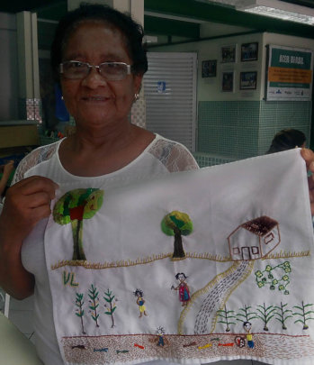 Valdete with her 'Childhood Memories' embroidery