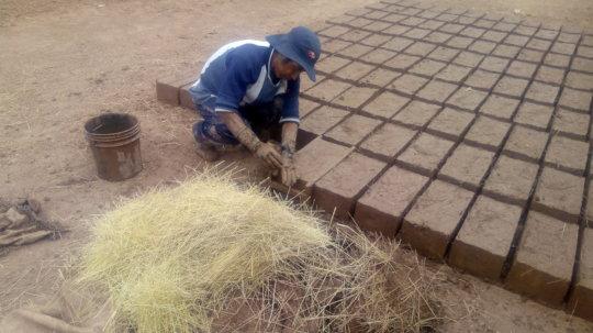 Adobe bricks being prepared for construction