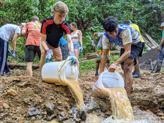 Students helped build an access bridge in Quepos