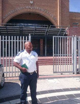 Inspector Siviwe Noko outside the Court