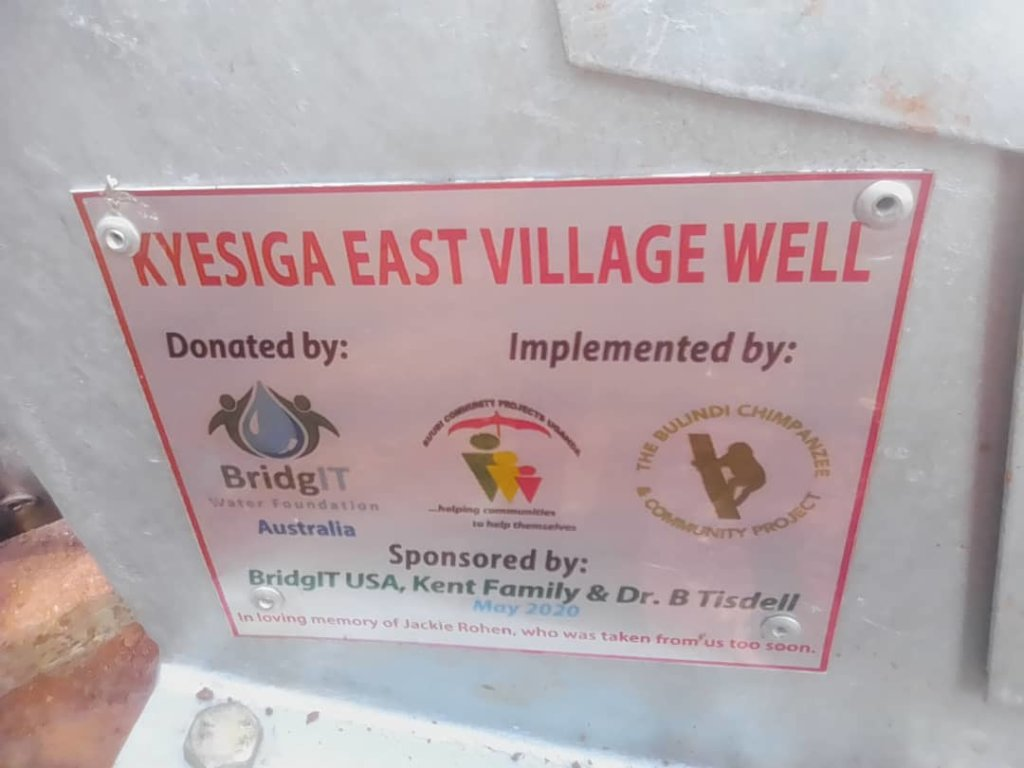 Plaque on completed Kyesiga East Well
