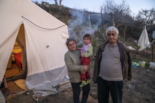 Naim and his family outside their tent