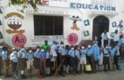 Providing books, desks & food to 300 slums kids.