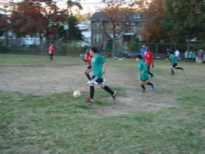 Middle school boys playing soccer
