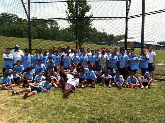 Soccer camp coaches, alumni volunteers and campers