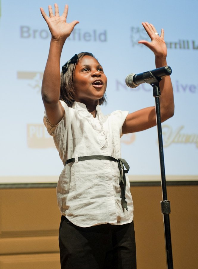 Dallas Otigba, an outstanding DC SCORES poet-athlete, uses her wide imagination to paint a picture for the audience while performing at the second annual Inspired Art Gala fundraiser.