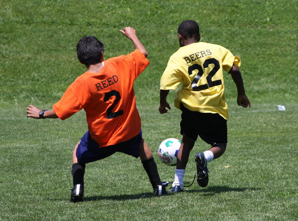 A pair of DC SCORES poet-athletes vie for the ball during one of the program