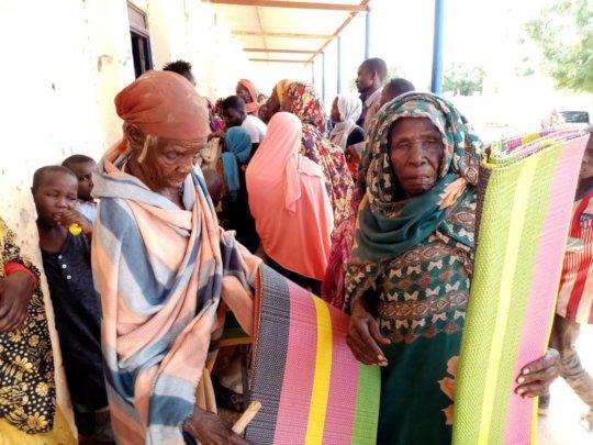 Kerending Camp residents receive tarps, blankets