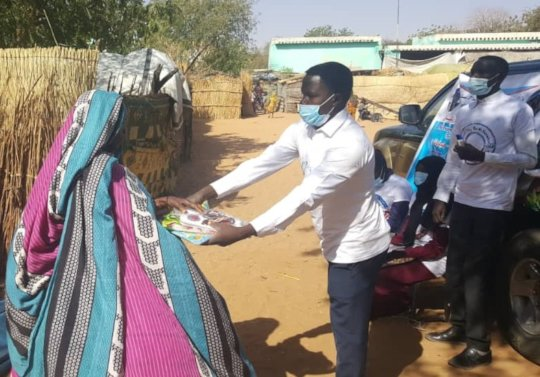 Giving clothes and shoes to disaplaced on March 1