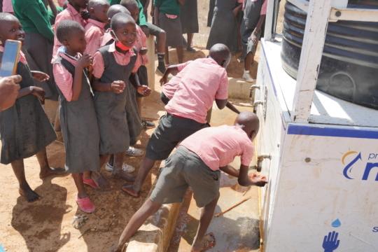 School children having a drink of clean water