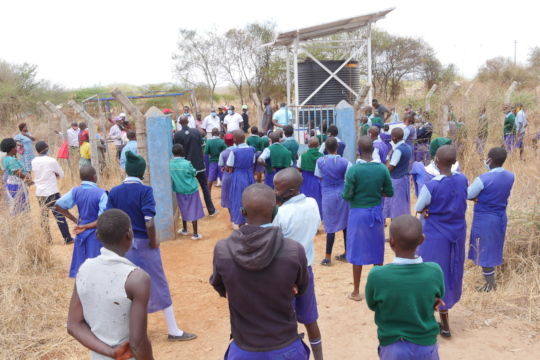 School children wait for the taps to open