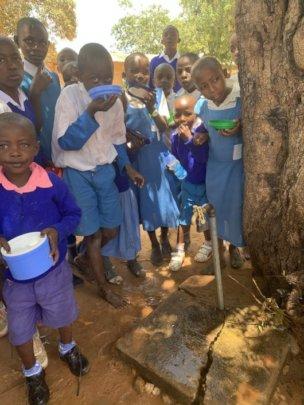 School children drinking from a handpump