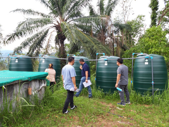 Examining the Temporary Water Collection Tanks