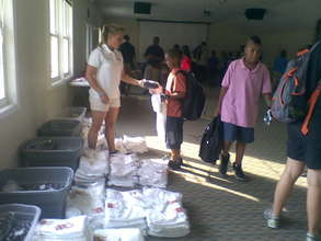 Handing out equipment and uniforms!