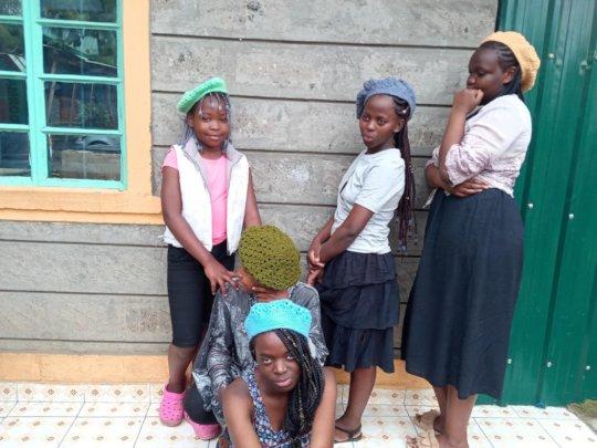 Girls showing their Crocheting work