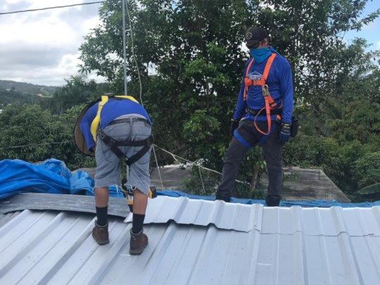 Jose Lopez working Dona Carmen's roof