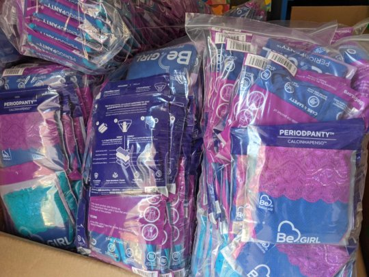 Boxes full of BeGirl period underwear for PS Girls