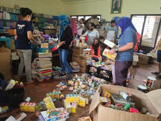 Teachers/volunteers sort and prepare care packages