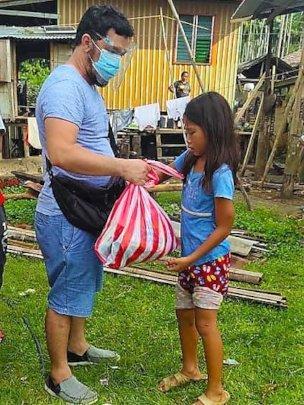 Girl receives care package from AAI volunteer
