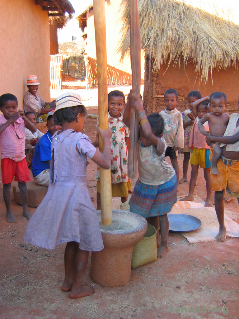Children pounding rice in Madagascar