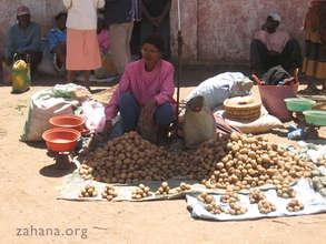 Potato vendor in a market in Madagasscar