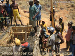 Building the water tank way up on the mountain