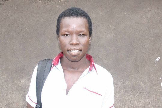 Adong, returns to school in seond term in Uganda