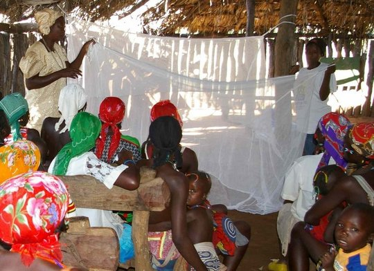 training on treating a mosquito net