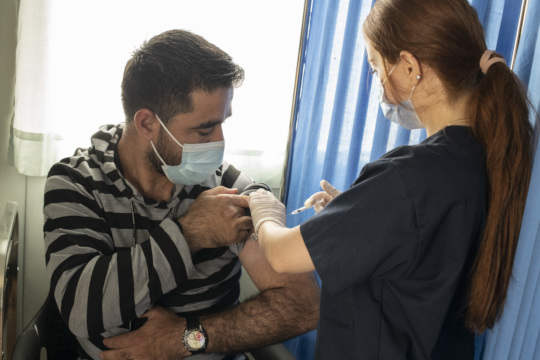 Our team administers a COVID-19 vaccine in Jordan