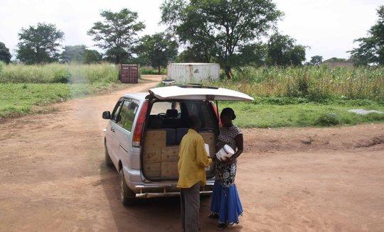 Delivering medicines for Omilling village clinic