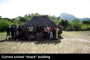 Community members in front of school shack