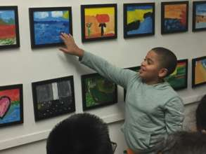 Student sharing his painting at field trip.