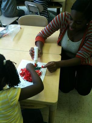 AFA intern Leslie assists in the LTA classroom.