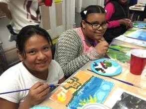 Students at field trip to Erick Sanchez's studio.