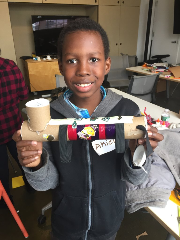 Student with his original flashlight design.