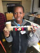 Student with his original flashlight design.