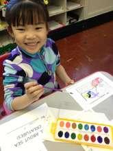 Happy participant in a visual arts workshop