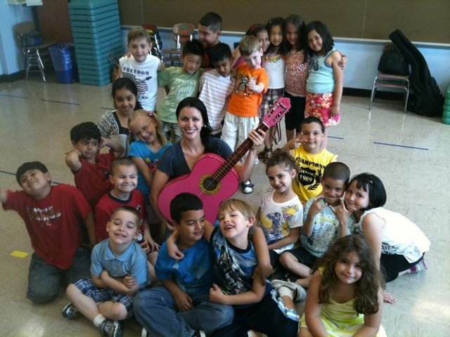 Teaching Artist, Robin Colwell, with students.