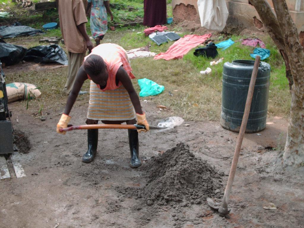 A woman making Red soil Block