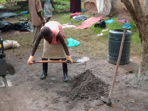 A woman making Red soil Block