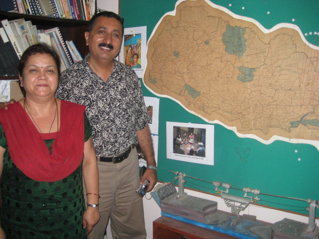Nandu and his wife in their home/office