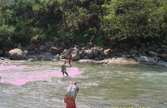 Survey team crosses the Dordi River