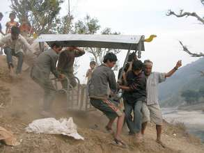 Villagers carry assembled chair to platform