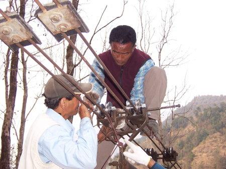 Village Solutions team repairs trolleys