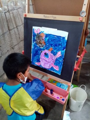Student concentrating on his painting